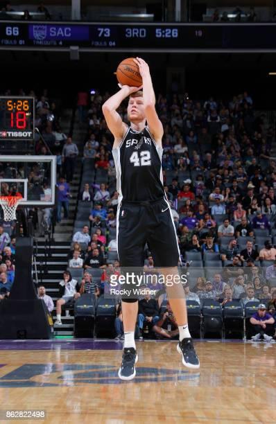 Davis Bertans of the San Antonio Spurs shoots a three pointer against the Sacramento Kings on October 2 2017 at Golden 1 Center in Sacramento...