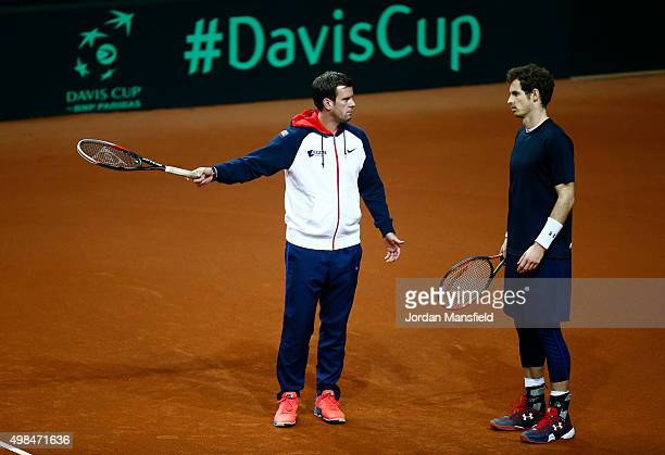 Davis Cup Captain Leon Smith talks with Andy Murray of Great Britain during a practice session at Flanders Expo on November 23 2015 in Ghent Belgium
