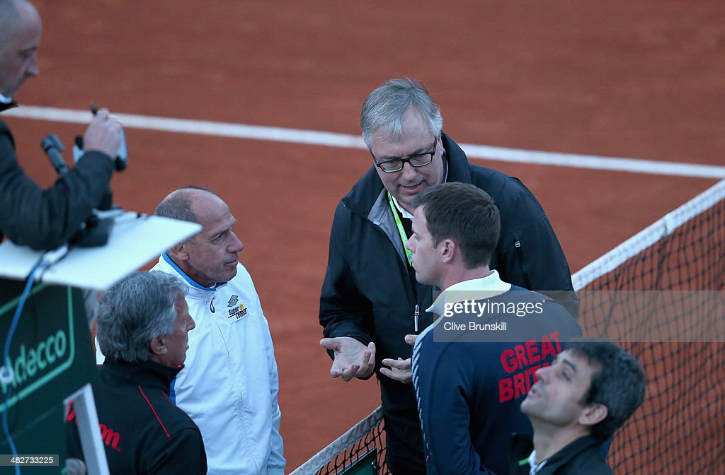 Davis Cup referee Stefan Fransson tells Italian team captain Carrado Barazzutti and British team captain Leon Smith that he is calling off the match for the night due to bad light Andy Murray of Great Britain and Andreas Seppi of Italy will resume the second rubber tomorrow, during day one of the Davis Cup World Group Quarter Final match between Italy and Great Britain at Tennis Club Napoli on April 4, 2014 in Naples, Italy.