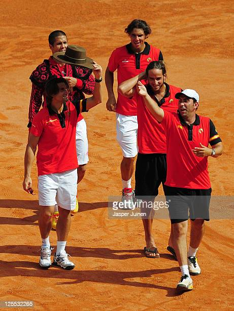 Davis Cup team captain Albert Costa Feliciano Lopez Rafael Nadal Fernando Verdasco and David Ferrer of Spain celebrate with the crowd after the last...