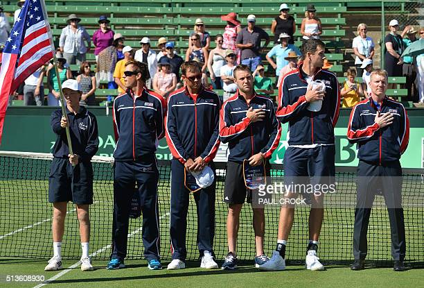 US Davis Cup team members Mike Bryan Bob Bryan Jack Sock John Isner and captain Jim Courier listen to the US national anthem ahead of their World...