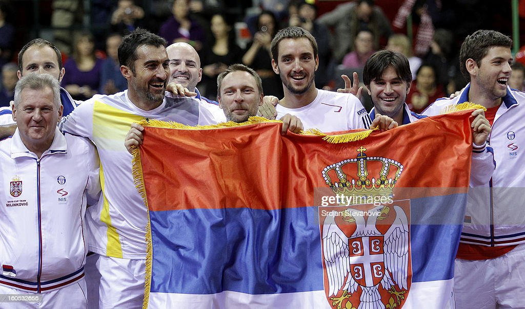 Davis Cup team of Serbia celebrate victory against Belgium after the Davis Cup doubles first round match between Belgium and Serbia, at Spirou dome February 02, 2013 in Charleroi, Belgium.