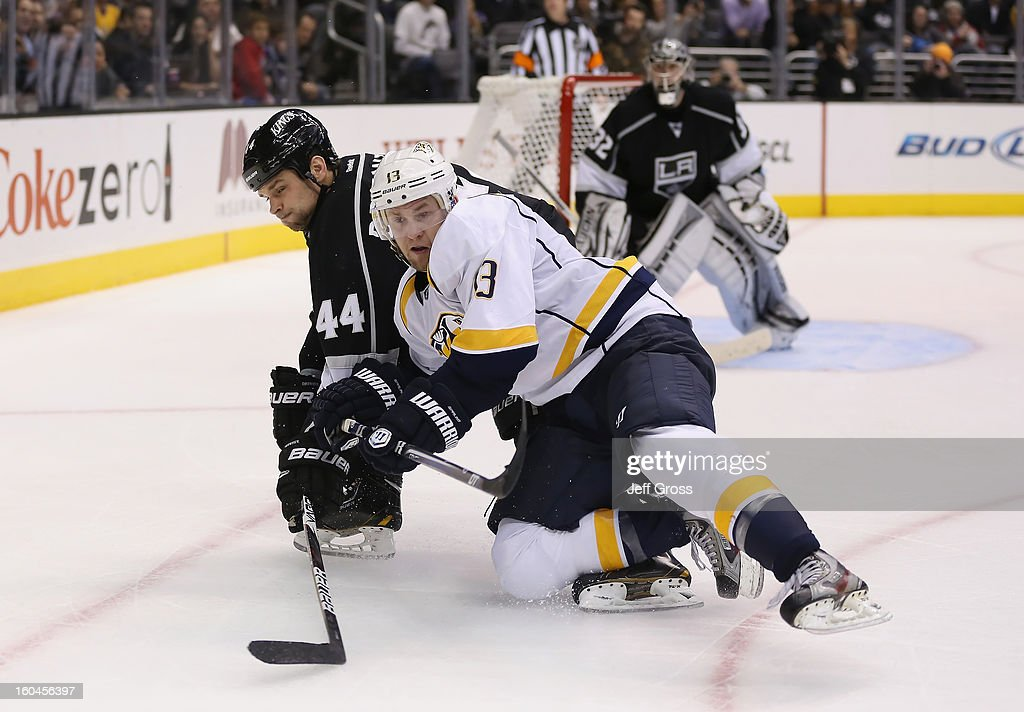 <a gi-track='captionPersonalityLinkClicked' href=/galleries/search?phrase=Davis+Drewiske&family=editorial&specificpeople=696711 ng-click='$event.stopPropagation()'>Davis Drewiske</a> #44 of the Los Angeles Kings and <a gi-track='captionPersonalityLinkClicked' href=/galleries/search?phrase=Nick+Spaling&family=editorial&specificpeople=4112920 ng-click='$event.stopPropagation()'>Nick Spaling</a> #13 of the Nashville Predators get tangled up in the third period at Staples Center on January 31, 2013 in Los Angeles, California. The Predators defeated the Kings 2-1 in a shootout.