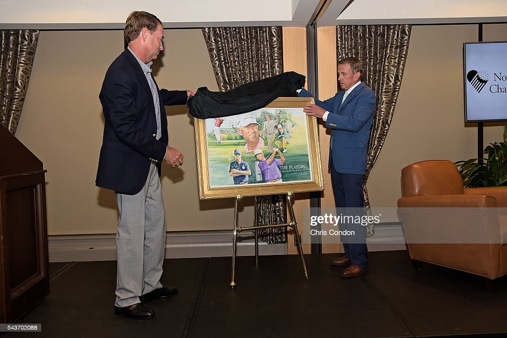 <a gi-track='captionPersonalityLinkClicked' href=/galleries/search?phrase=Davis+Love+III&family=editorial&specificpeople=564618 ng-click='$event.stopPropagation()'>Davis Love III</a> and PGA TOUR Commissioner <a gi-track='captionPersonalityLinkClicked' href=/galleries/search?phrase=Tim+Finchem&family=editorial&specificpeople=794264 ng-click='$event.stopPropagation()'>Tim Finchem</a> unveil the 2016 Ambassador of Golf portrait during a ceremony prior to the World Golf Championships-Bridgestone Invitational at Firestone Country Club on June 29, 2016 in Akron, Ohio.