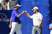 Davis Love III congatulates Ryan Moore after Moore holed out for birdie from off of the green on the 17th hole during the final round of the Wyndham...