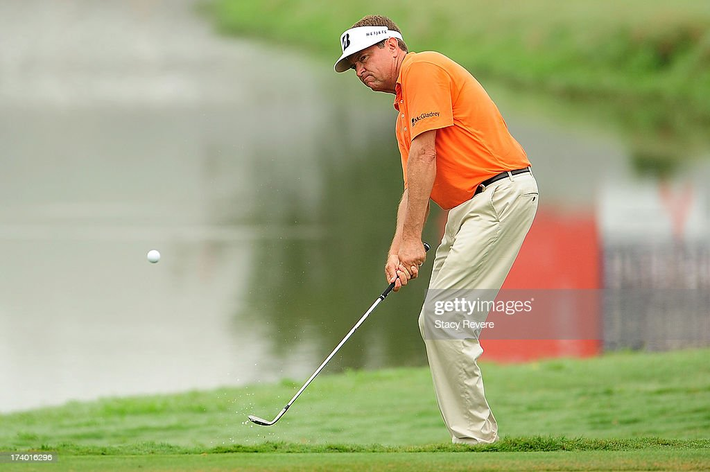 Davis Love III hits his third shot on the ninth hole during a continuation of the first round of the Sanderson Farms Championship at Annandale Golf Club on July 19, 2013 in Madison, Mississippi.