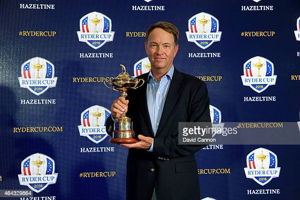 Davis Love III holds the Ryder Cup Trophy as he poses for the media during his announcement as the 2016 United States Ryder Cup Team Captain at the...