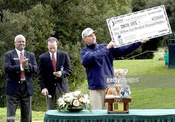 Davis Love III holds up his winning check of $1000