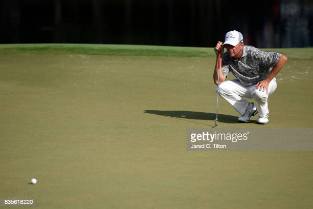 Davis Love III lines up his birdie putt on the 15th green during the third round of the Wyndham Championship at Sedgefield Country Club on August 19...