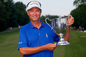 Davis Love III poses with the Sam Snead Cup after winning the Wyndham Championship at Sedgefield Country Club on August 23 2015 in Greensboro North...
