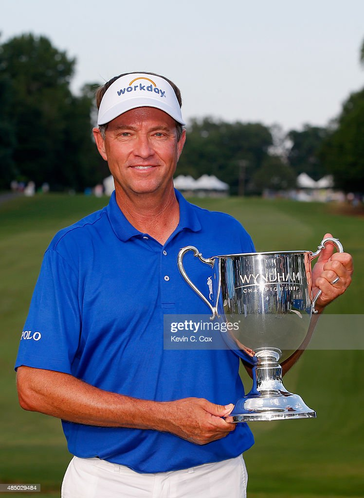 Davis Love III poses with the Sam Snead Cup after winning the Wyndham Championship at Sedgefield Country Club on August 23, 2015 in Greensboro, North Carolina.