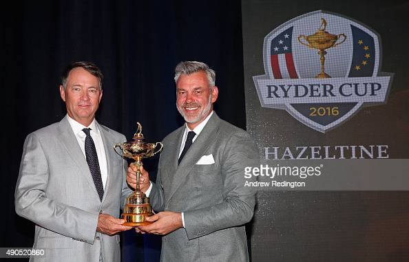 Davis Love III US Ryder Cup Captain and Darren Clarke European Ryder Cup Captain pose with the trophy following the 2016 Ryder Cup Captains' Press...