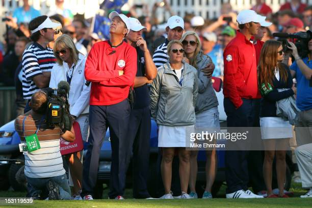 Davis Love III waits with some of his team at the end of the Singles Matches for The 39th Ryder Cup at Medinah Country Club on September 30 2012 in...
