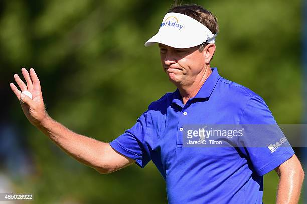 Davis Love III waves to the crowd on the 18th green during the final round of the Wyndham Championship at Sedgefield Country Club on August 23 2015...