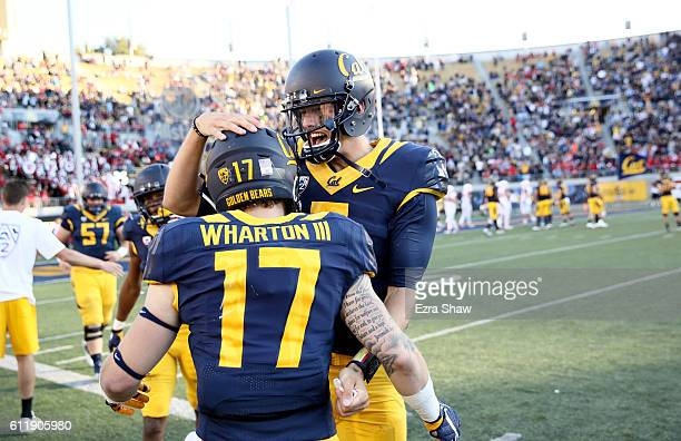 Davis Webb of the California Golden Bears is congratulated by Vic Wharton III after Webb threw a touchdown pass against the Utah Utes at California...