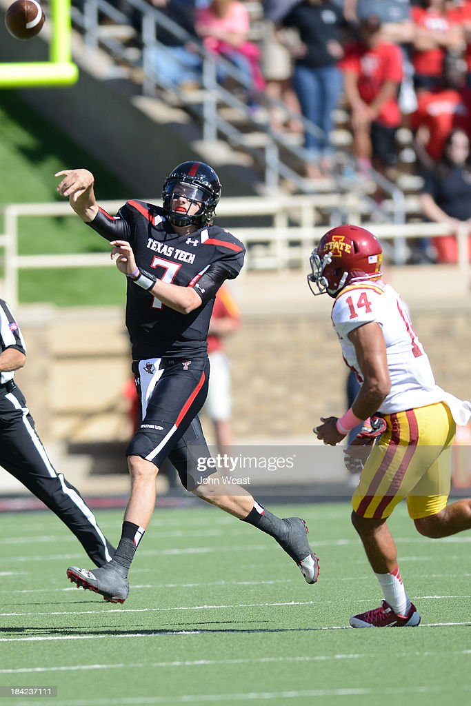 Davis Webb #7 of the Texas Tech Red Raiders attempts a pass while being chased by Jared Brackens #14 of the Iowa State Cyclones during game action on October 12, 2013 at AT&T Jones Stadium in Lubbock, Texas. Texas Tech won the game over Iowa State 42-35.