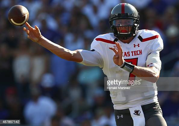Davis Webb of the Texas Tech Red Raiders throws the ball against the TCU Horned Frogs at Amon G Carter Stadium on October 25 2014 in Fort Worth Texas