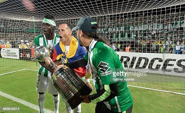 Davison Sanchez Alejandro Guerra and Sebastian Perez of Nacional celebrate with the trophy after a second leg final match between Atletico Nacional...