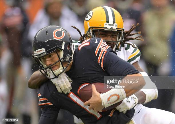 Davon House of the Green Bay Packers sacks quarterback Mitchell Trubisky of the Chicago Bears in the third quarter at Soldier Field on November 12...