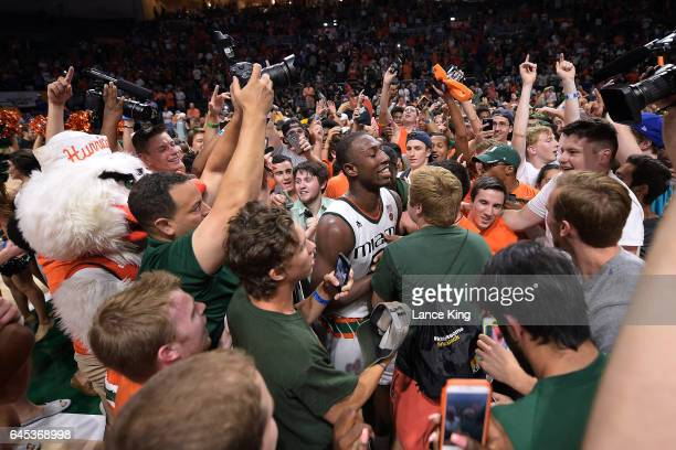 Davon Reed of the Miami Hurricanes celebrates with fans following their 5550 win against the Duke Blue Devils at Watsco Center on February 25 2017 in...