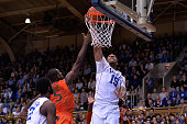 Davon Reed of the Miami Hurricanes fouls Jahlil Okafor of the Duke Blue Devils during their game at Cameron Indoor Stadium on January 13 2015 in...