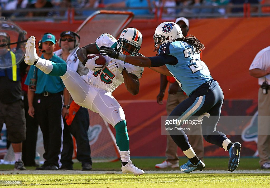 Davone Bess #15 of the Miami Dolphins makes a catch over <a gi-track='captionPersonalityLinkClicked' href=/galleries/search?phrase=Jason+McCourty&family=editorial&specificpeople=4037211 ng-click='$event.stopPropagation()'>Jason McCourty</a> #30 of the Tennessee Titans during a game at Sun Life Stadium on November 11, 2012 in Miami Gardens, Florida.