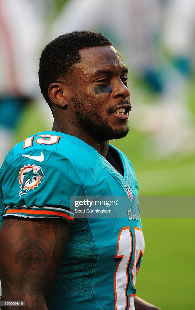 Davone Bess #15 of the Miami Dolphins warms up before the game against the Atlanta Falcons at Sun Fife Stadium on August 24, 2012 in Miami Gardens, Florida.
