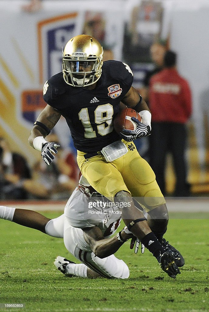 Davonte' Neal #19 of the Notre Dame Fighting Irish carries the ball against the Alabama Crimson Tide during the 2013 Discover BCS National Championship Game at Sun Life Stadium on January 7, 2013 in Miami Gardens, Florida.