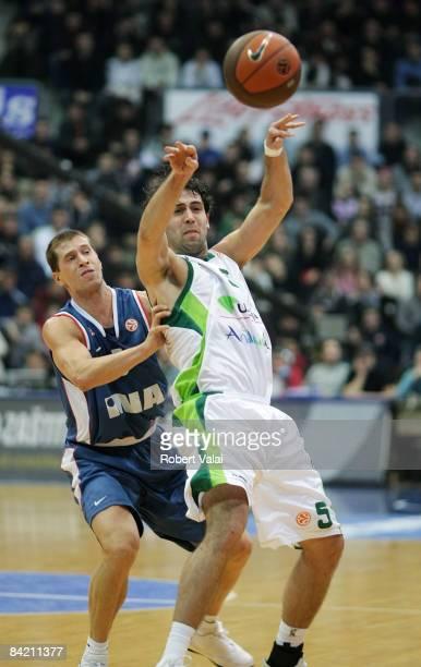 Davor Kus #5 of Cibona competes with Berni Rodríguez #5 of Unicaja during the Euroleague Basketball Game 9 match between Cibona Zagreb and Unicaja on...