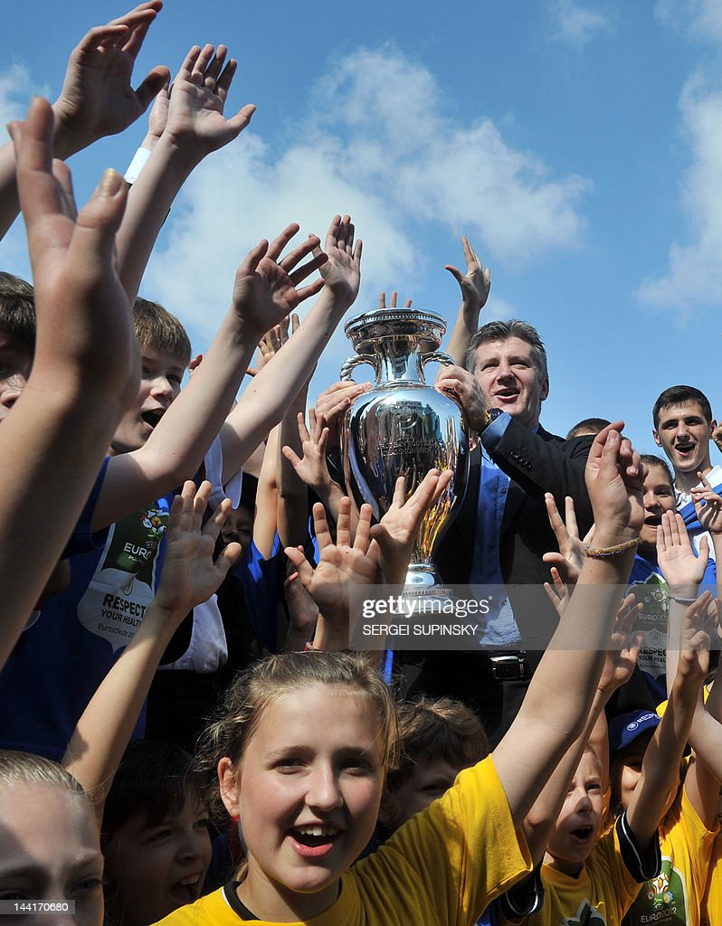Davor Suker, former footballer and UEFA ambassador, holds a EURO 2012 tournament cup during A meeting with young Ukrainian football players in Kiev on May 11, 2012. Along with tournament co-hosts Poland and Ukraine, European football's governing body UEFA has organised a five-week trophy tour in cities across the two countries.