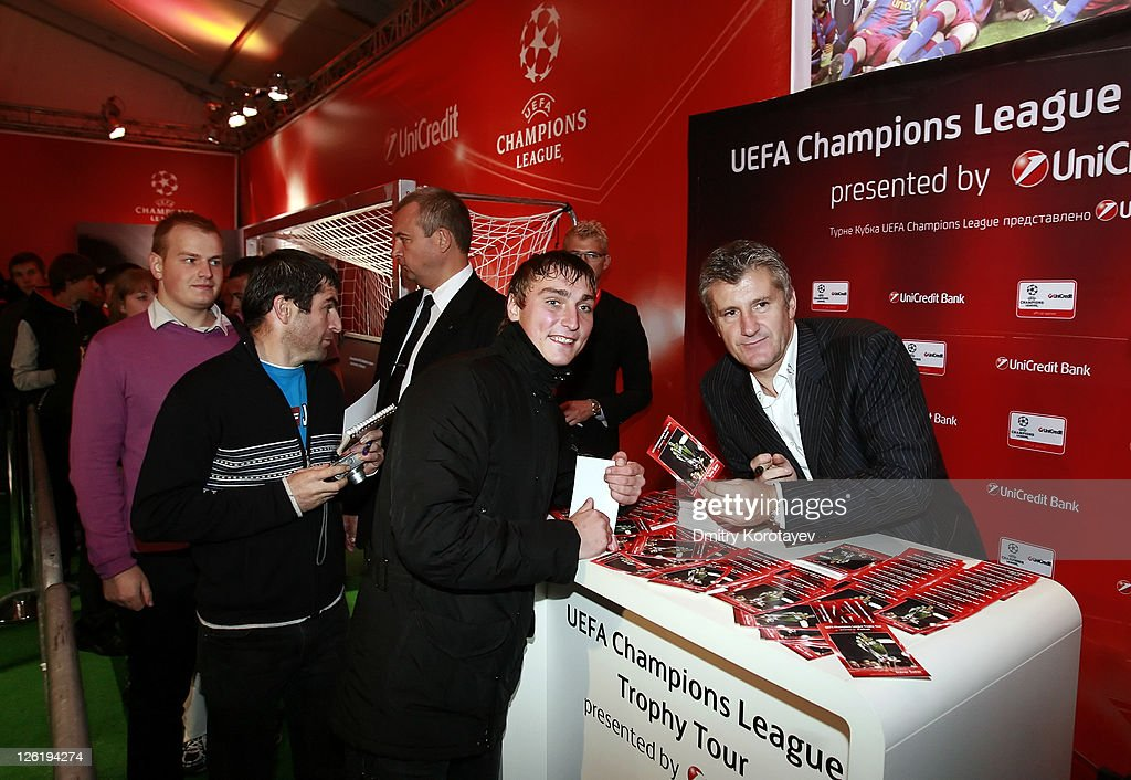 <a gi-track='captionPersonalityLinkClicked' href=/galleries/search?phrase=Davor+Suker&family=editorial&specificpeople=235899 ng-click='$event.stopPropagation()'>Davor Suker</a> signs autographs for the fans during the UEFA Champions League Trophy Tour 2011 on September 23, 2011 in Moscow, Russia.