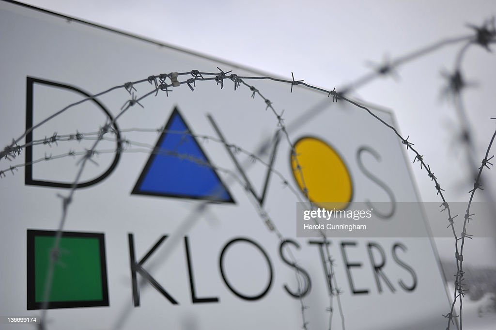 A Davos sign is displayed behind barbed wire at the village entrance on January 10, 2012 in Davos, Switzerland. The World Economic Forum, which gathers the World's top leaders, runs from January 25 - 29.