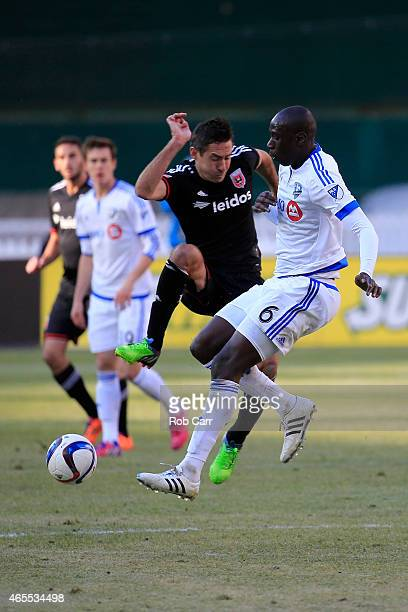 Davy Arnaud of DC United and Hassoun Camara of Montreal Impact go after the ball during the second half of DC United's 10 win at RFK Stadium on March...