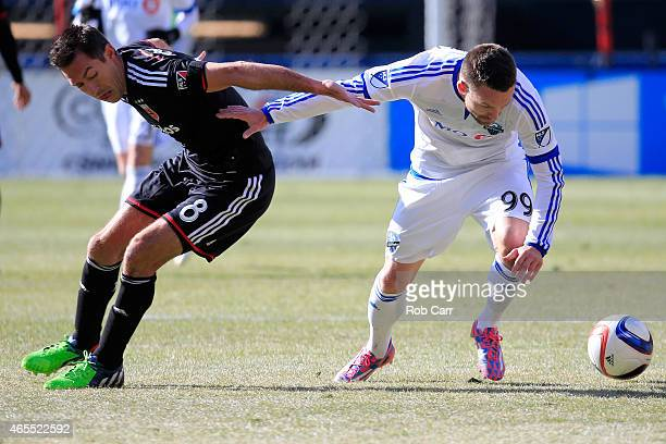 Davy Arnaud of DC United and Jack McInerney of Montreal Impact go after the ball during the first half at RFK Stadium on March 7 2015 in Washington DC