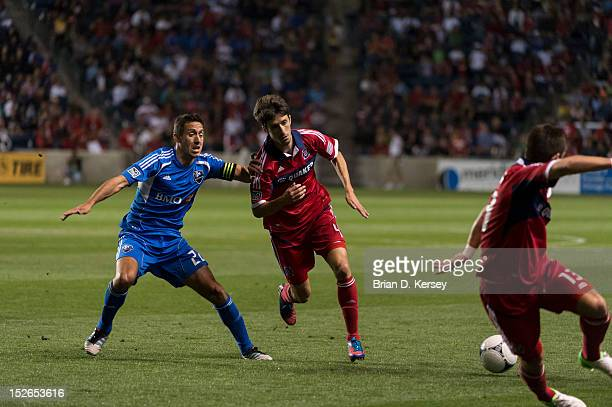 Davy Arnaud of Montreal Impact and Alvaro Fernandez of Chicago Fire chase after the ball at Toyota Park on September 15 2012 in Bridgeview Illinois...