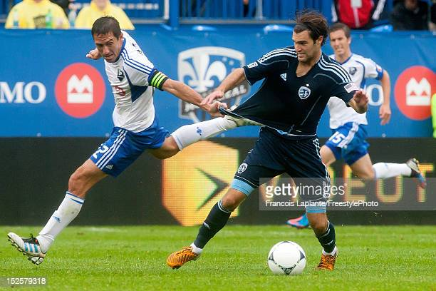 Davy Arnaud of the Montreal Impact grabs the jersey of Michael Harrington of the Sporting KC as he keep control of the ball during the MLS match at...