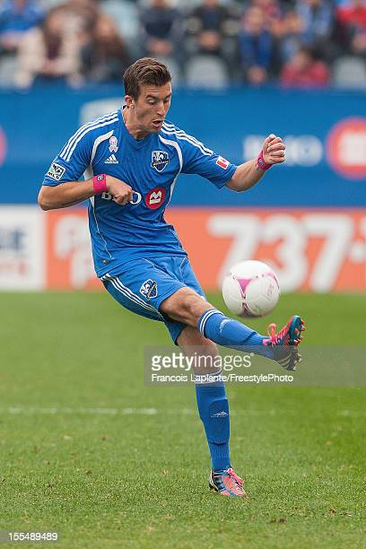 Davy Arnaud of the Montreal Impact kicks the ball against the New England Revolution during the MLS match at Saputo Stadium on October 27 2012 in...