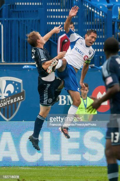 Davy Arnaud of the Montreal Impact loses balance as he jumps for a header against xxx of the Sporting KC during the MLS match at Saputo Stadium on...