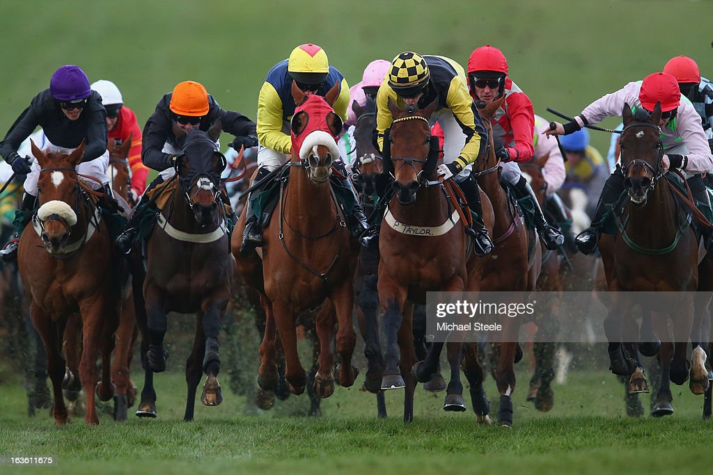 Davy Condon riding Flaxen Flare (C, red nose band) on his way to victory from Habesh ridden by Paddy Kennedy (3R) in the Fred Winter Juvenile Handicap Hurdle race during Ladies Day at Cheltenham Racecourse on March 13, 2013 in Cheltenham, England.