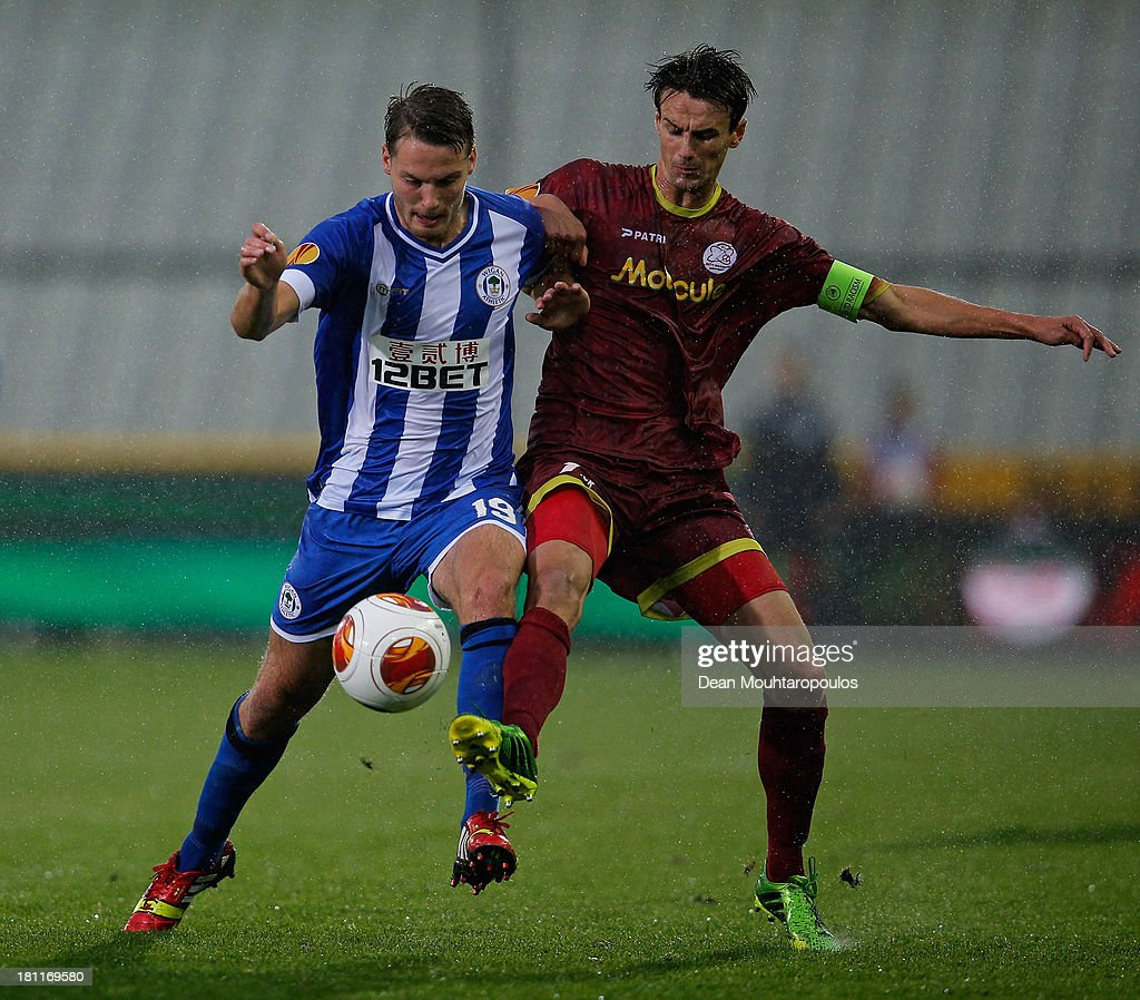 Davy De Fauw of Waregem and Nick Powell of Wigan battle for the ball during the UEFA Europa League Group D match between SV Zulte Waregem and Wigan Athletic at the Jan Breydelstadion on September 19, 2013 in Waregem, Belgium.