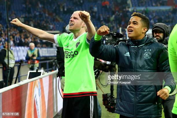 Davy Klaassen and Justin Kluivert of Amsterdam celebrate losing 23 but qualified for the semi final match after the UEFA Europa League quarter final...