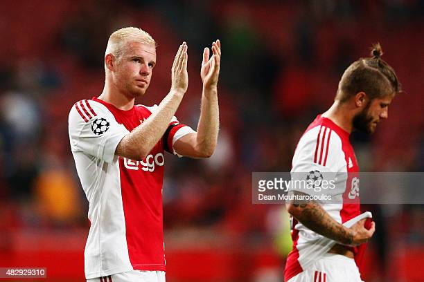 Davy Klaassen and Lasse Schone of Ajax look dejected after defeat in the third qualifying round 2nd leg UEFA Champions League match between Ajax...