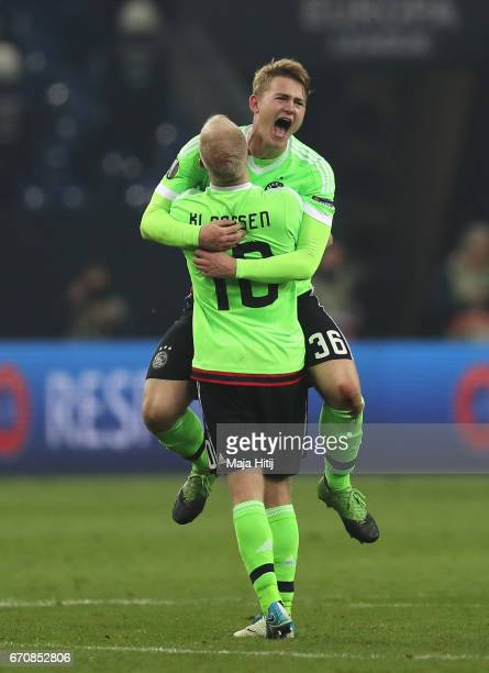 Davy Klaassen and Matthijs de Ligt of Ajax celebrate after the UEFA Europa League quarter final second leg match between FC Schalke 04 and Ajax...