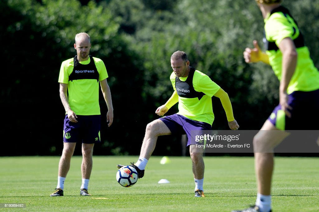 Davy Klaassen (L) and Wayne Rooney of Everton during pre-season training on July 18, 2017 in De Lutte, Netherlands.