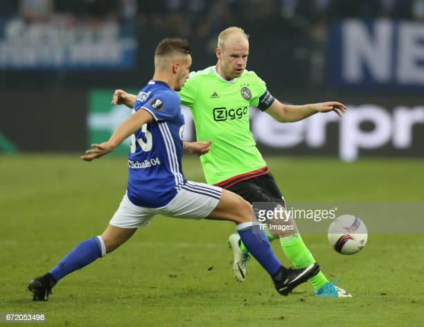 Davy Klaassen of Ajax Amsterdam and Donis Avdijaj of Schalke battle for the ball during the UEFA Europa League quarter final second leg match between...