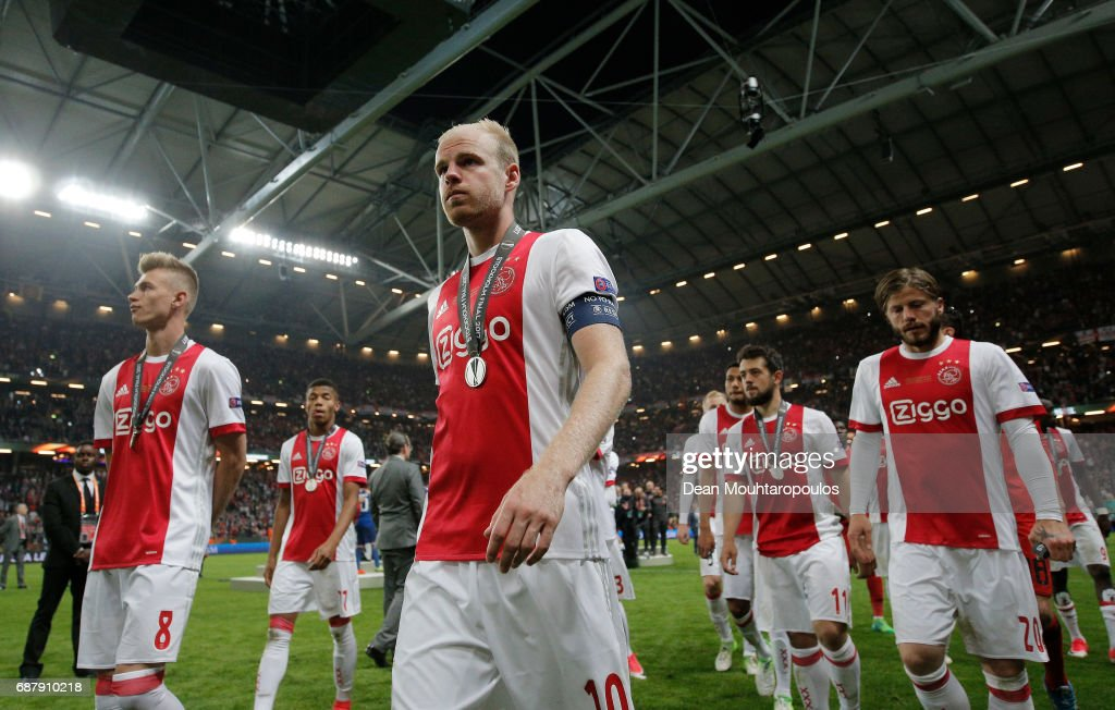 Davy Klaassen of Ajax and his team mates leave the pitch looking dejected following defeat in the UEFA Europa League Final between Ajax and Manchester United at Friends Arena on May 24, 2017 in Stockholm, Sweden.