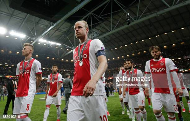 Davy Klaassen of Ajax and his team mates leave the pitch looking dejected following defeat in the UEFA Europa League Final between Ajax and...
