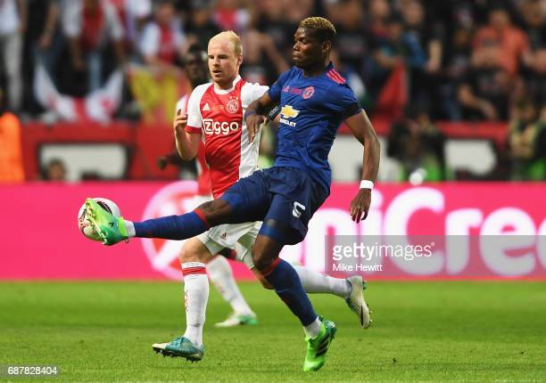 Davy Klaassen of Ajax and Paul Pogba of Manchester United in action during the UEFA Europa League Final between Ajax and Manchester United at Friends...