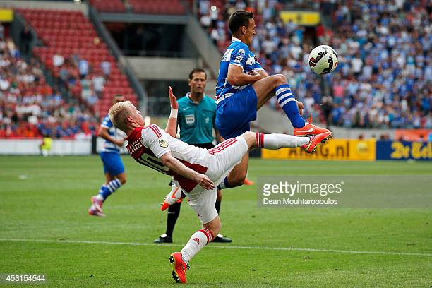 Davy Klaassen of Ajax and Trent Sainsbury of Zwolle battle for the ball during the 19th Johan Cruijff Shield match between Ajax Amsterdam and PEC...