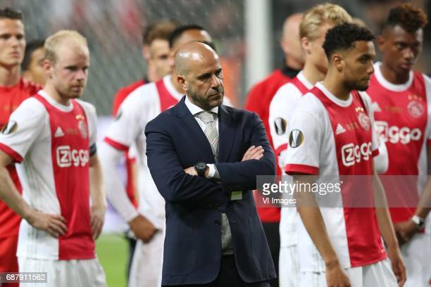 Davy Klaassen of Ajax coach Peter Bosz of Ajax Jairo Riedewald of Ajaxduring the UEFA Europa League final match between Ajax Amsterdam and Manchester...